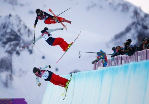Drew, Sigourney (C) and Bowman of U.S. practice during warm sessions ahead of women's freestyle skiing halfpipe qualification round at 2014 Sochi Winter Olympic Games in Rosa Khutor